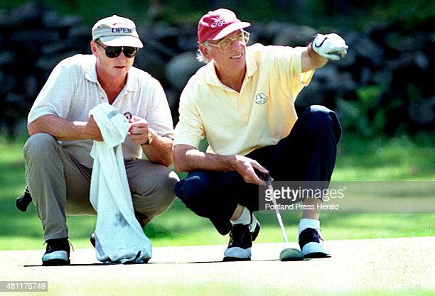 Staff Photo by Gordon Chibroski Wednesday July 12 2000 Les Flesher right and his caddie Bob Calcagni discuss the break in the green prior to his...
