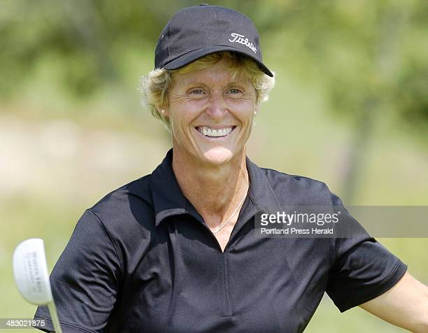 Staff Photo by Gordon Chibroski Wednesday July 27 2005 Lori Frost is all smiles after sinking the winning putt to take the Maine Women's Amateur...