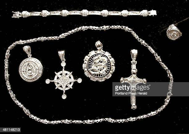 Staff Photo by Gordon Chibroski Wednesday September 5 2001 This assorment of Sterling Silver urban jewelry from City Soul Jewelry at 10 Exchange St...