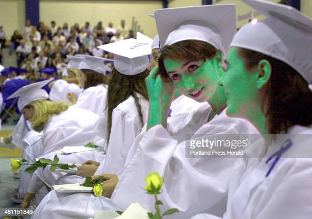 Staff photo by Gregory Rec Friday June 16 2000 Courtney Mitchell adjusts her cap during graduation at Kennebunk High School on Sunday June 11