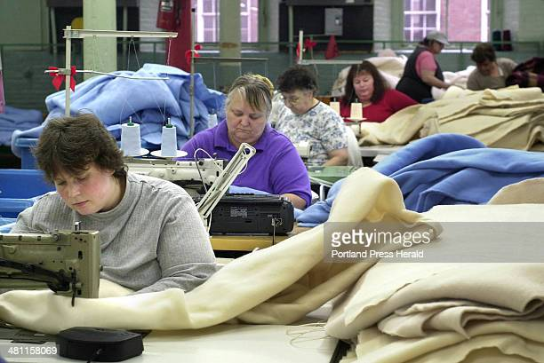 Staff photo by Gregory Rec Friday November 30 2001 Norma Wood sews a connector into an electric blanket at Biddeford Textile Sewing behind her are...
