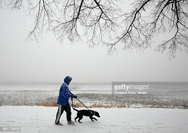 Staff photo by Gregory Rec Gretchen Spann walks her 5monthold black lab Daisy through the snow along Baxter Boulevard in Portland on Saturday...
