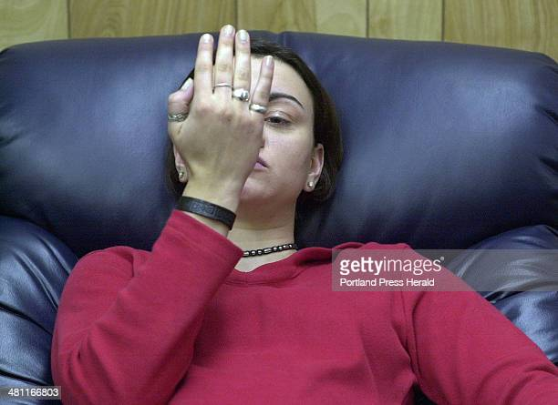 Staff photo by Gregory Rec Monday May 21 2001 Already in a state of hypnosis Stef Chiaradonna focuses on her hand as Rene Bastarache brings her into...