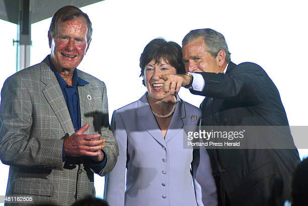 Staff Photo by Gregory Rec Sat Aug 03 2002 President George W Bush points out a person in the audience to Senator Susan Collins and George H Bush...