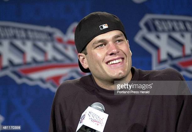 Staff photo by Gregory Rec Thursday January 31 2001 Tom Brady was all smiles at a press conference on Thursday after being named starting quarterback...