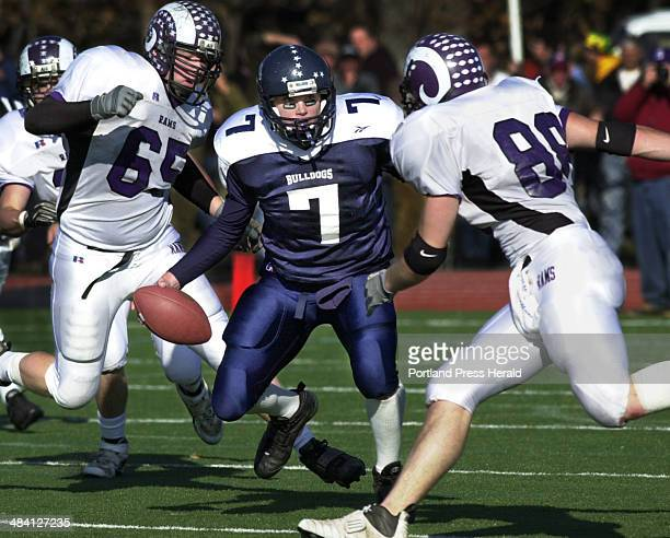 Staff Photo by Gregory Rec Thursday November 27 2003 Portland's Matt Chason is about to become the main ingredient in a quarterback sandwich made by...