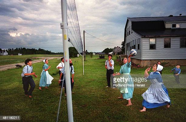 Staff Photo by Gregory Rec Tue Jul 02 2002 The Kauffman family plays volleyball after dinner in back of their home in Smyrna The family is one of...