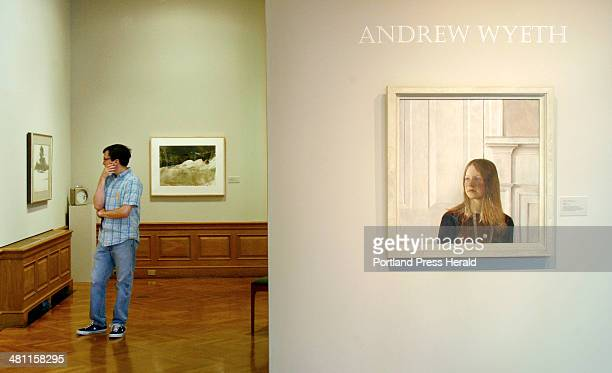 Staff Photo by Gregory Rec Tuesday June 3 2003 Jason Stumf takes in a painting in the exhibit Andrew Wyeth Ericksons at the Farnsworth Museum in...