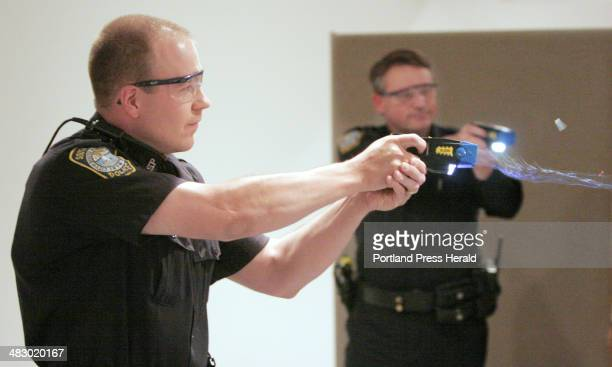 Staff photo by Gregory Rec Wednesday May 10 2006 Christopher Todd an officer with the South Portland police department fires his taser gun during a...