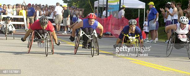 Staff Photo by Herb Swanson Sat Aug 04 2001 Wheelchair racers take off at the start of the Peoples Beach to Beacon 10K race Saturday in Cape Elizabeth
