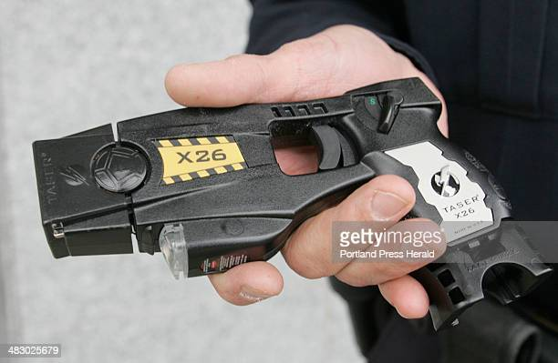 Staff Photo by Herb Swanson Saturday April 23 2005 South Portland police officer Adam Howard holds the latest version of the Taser X26 stun gun