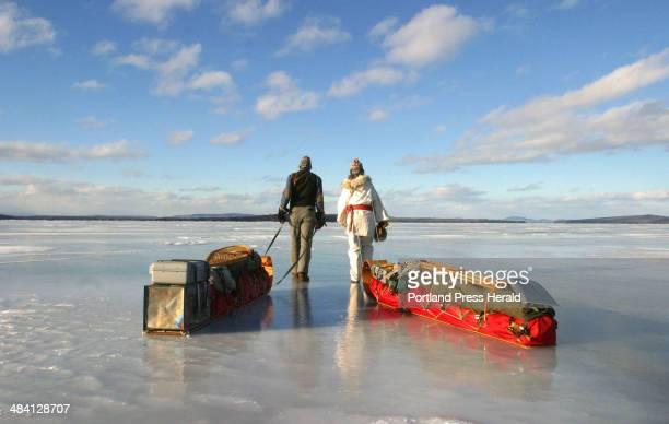 Staff Photo by Herb Swanson Saturday January 15 2005 Alexandra and Garrett Conover walk along frozen Moosehead Lake during the first day of their...