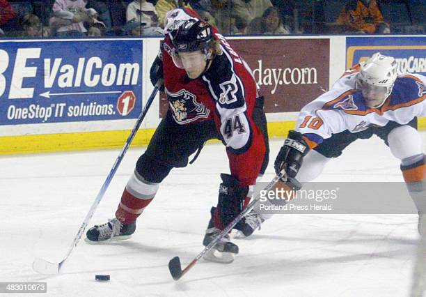Staff Photo by Herb Swanson, Saturday, March 12, 2005: Portland Pirates Brooks Laich and Philadelphia Phantom Joni Pitkanen fight for the puck during...