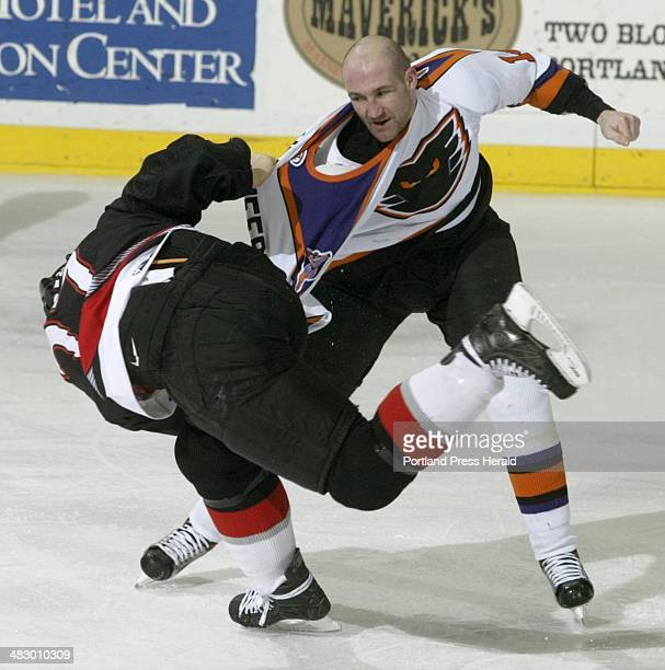 Staff Photo by Herb Swanson Sunday March 14 2004 Portland Pirate Mel Angelstad and Mike Peluso of the Philadelphia Phantoms get into a fight during...