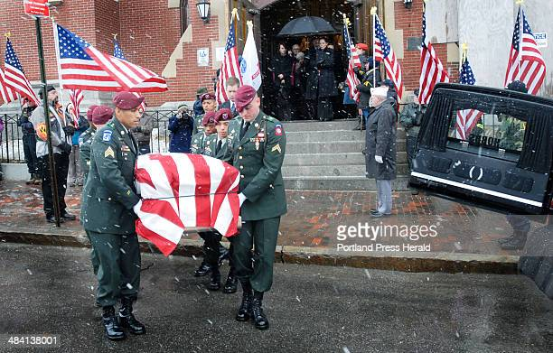 Staff photo by Jack Milton: A funeral detail from the Army's 82nd Airborne Division carries the coffin of Sgt. Jason Swiger from his funeral service...