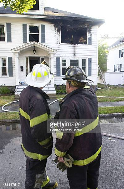 Staff Photo by Jack Milton Sun Sep 09 2001 Portland firefighters investigate the cause of a twoalarm fire at 59 Brentwood St The home was owned by...