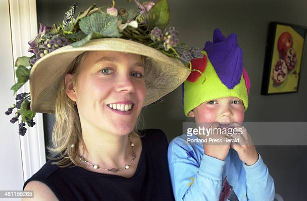 Staff Photo by Jack Milton, Tuesday, June 10, 2003: Kendra Haskell and her son Connor LaChance model hats she made. Hers is an elaborate floral...