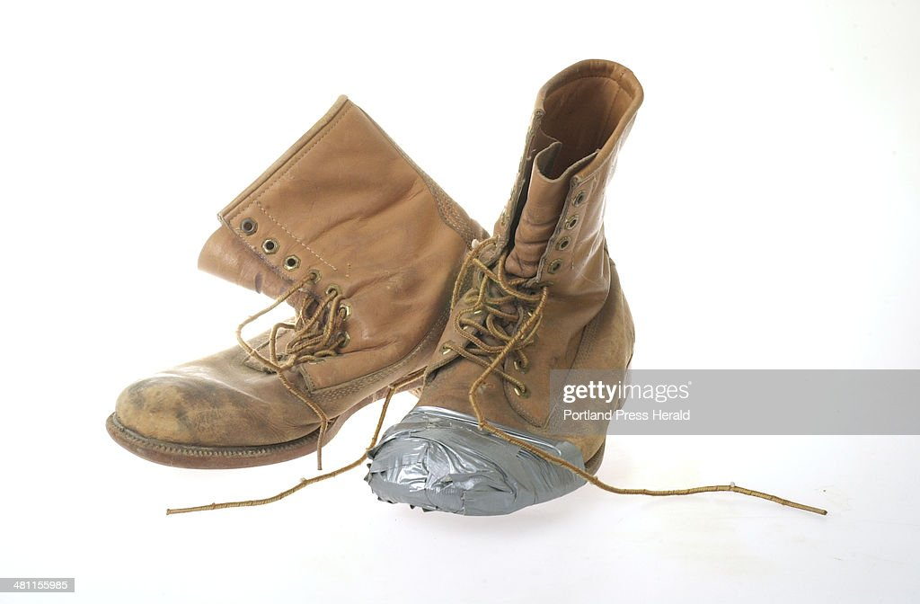 Boots with duct tape. : News Photo