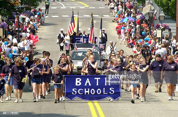 Staff Photo by Jill Brady, Friday, July 4, 2003: Student band members representing Bath schools march up Centre Street in downtown Bath while...
