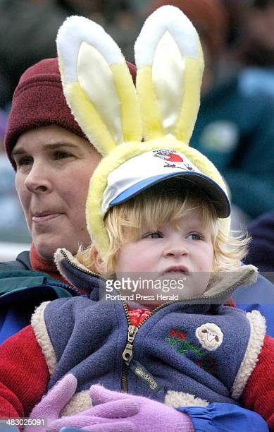 Staff Photo by Jill Brady Sunday April 16 2006 Two yearold Hannah Perfetti of Cumberland enjoys the Sea Dogs game Sunday in the Easter spirit with...