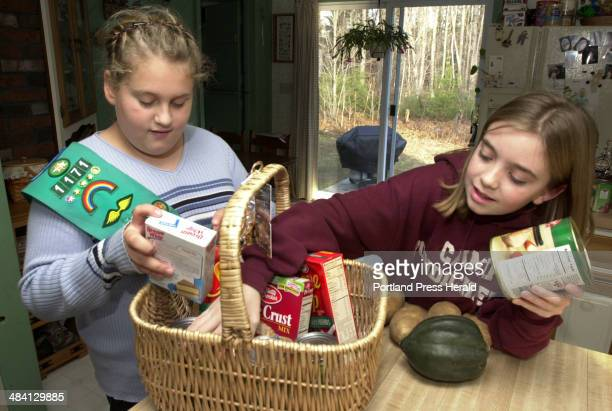 Staff Photo by Jill Brady Sunday November 23 2003 Taylor Hammond left and Katie Bennett both of Girl Scout Junior Troop 1171 in Gorham pack a...