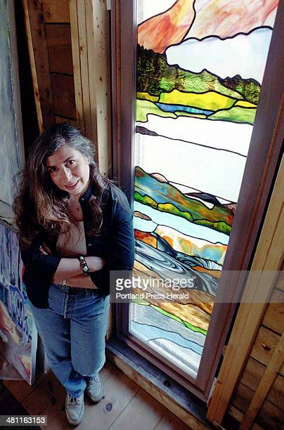 Staff Photo by Jill Brady Tue May 29 2001 Aviva Rahmani stands next to the vertical stained glass window she created as part of her preparation...