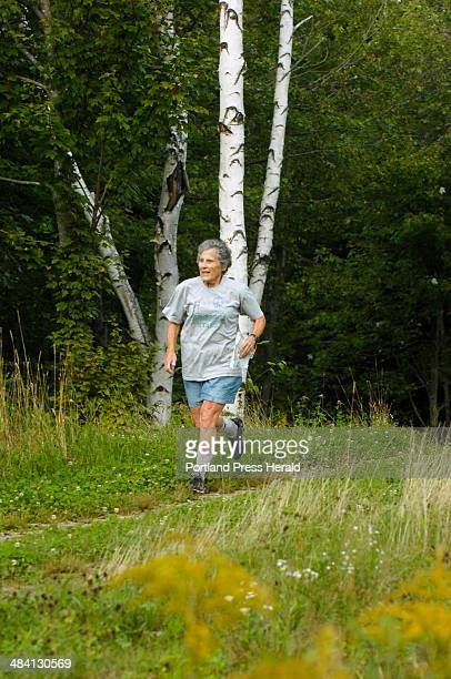 20060906 Wednesday September 6 2006 Ruth Johnson of Scarborough runs on an orienteering course at Pineland farm in New Gloucester recently An...