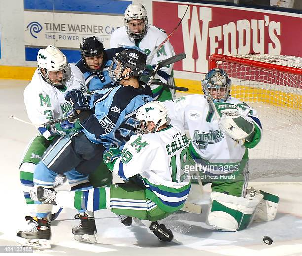 20061216 Saturday December 16 2006 University of Maine hockey player Vince Laise is dragged down by Mercyhurst's Cody Collins during a scramble for a...