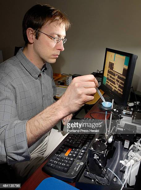 Staff Photo by John Ewing: 20070425 -- Wednesday, April 25, 2007 -- ..David Palmlund tests industrial diamonds, used in abrasives, for shape, size...