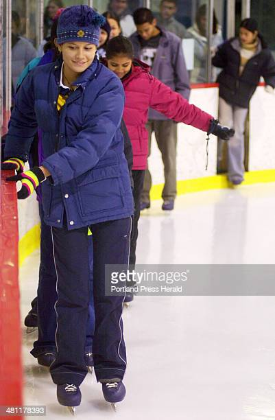 Staff Photo by John Ewing Fri Jan 03 2003 Costa Rican exchange students led by Diana Pinar tentatively get their first feel of being on ice skates...