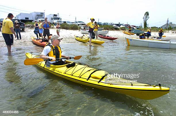 Staff Photo by John Ewing Friday June 24 2005 Jeff Knox from Milford Massachusetts hits the water with his fellow kayakers taking part in a Northeast...