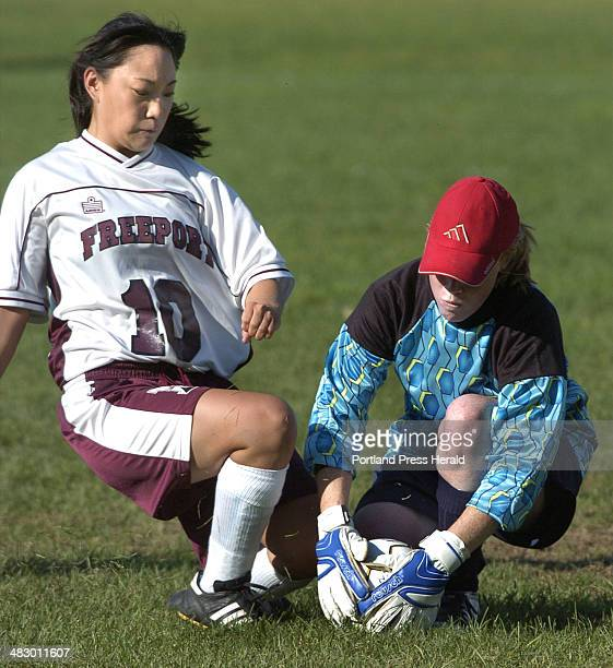 Staff Photo by John Ewing Friday September 2 2005 GrayNew Gloucester goalie Emma Lobozzo covers up a bounding ball just in front of Freeport's Mae...