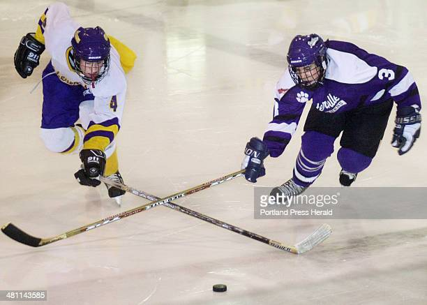 Staff Photo by John Ewing Thu Feb 14 2002 Cheverus Shawn Hawthorne and Waterville's#3 Corey Gardiner vie for for loose puck at mid ice in a game...