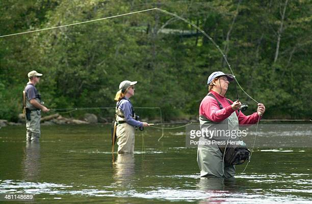 Staff Photo by John Ewing, Thursday, September 4, 2003: Flyfishermen cast for landlocked salmon at the Big Eddy pool on the West Branch of the...