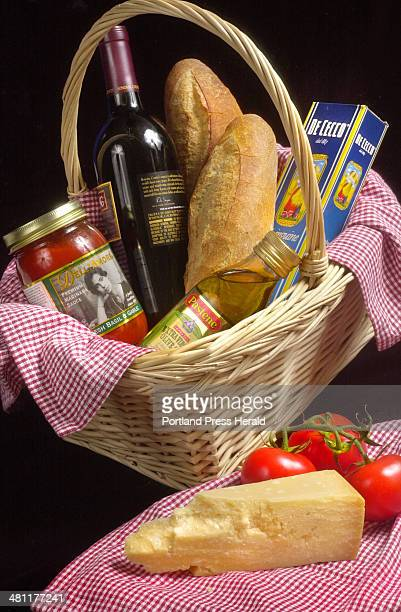 Staff Photo by John Ewing Tue Jul 10 2001 A picnic basket holding all the neccessities for an authentic Italian pasta dinner makes a fine gift for...