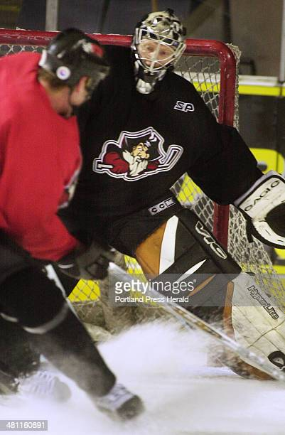 Staff Photo by John Ewing Tue Nov 20 2001 Pirates goalie Corey Hirsch looks to block a shot during practice on Tuesday morning