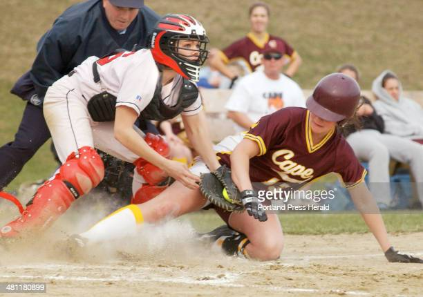 Staff Photo by John Ewing Tuesday April 15 2003 Wells catcher Christie Hotzler keeps an eye the baserunner after tagging out Cape Elizabeth's...