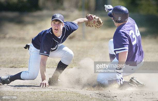 Staff Photo by John Ewing Tuesday April 19 2005 Westbrook shortstop Jack Beliveau looks to the umpire for the out call after tagging Deering's Josh...