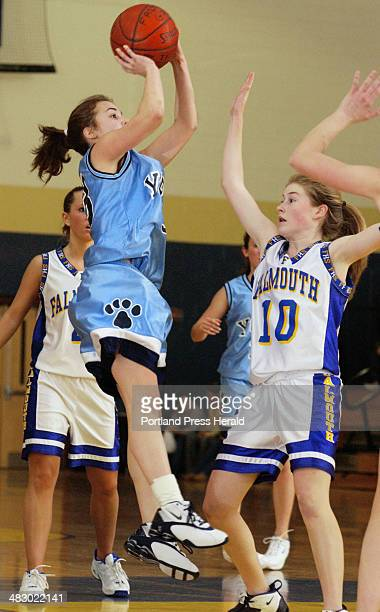 Staff Photo by John Ewing Tuesday February 10 2004 York's Whitney Westman takes a pullup jumper in front of Falmouth's Cara Kilroy