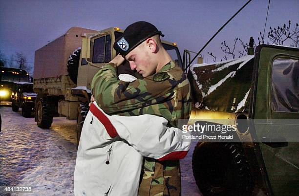 Staff Photo by John Ewing Tuesday January 6 2004 Spc3 Franz Oberlerchner shares an emotional goodbye hug with Erin Corey before departing with fellow...