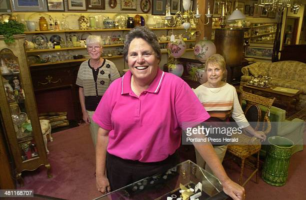 Staff Photo by John Ewing Wed Jul 24 2002 Jo Agnes Pasquarella owner of Cherished Possessions a consignment shop on Cottage Road in South Portland...