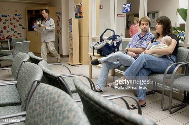 Staff Photo by John Ewing Wednesday August 15 2001 Ethan Hartenberg and his wife Kristine wait in the Maine Medical Center emergency room for a...