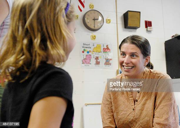 Wednesday August 30 2006 Emily Wright a first grade teacher at Freeport's Morse Street School greets incoming student Isabel Peredy at an open house...