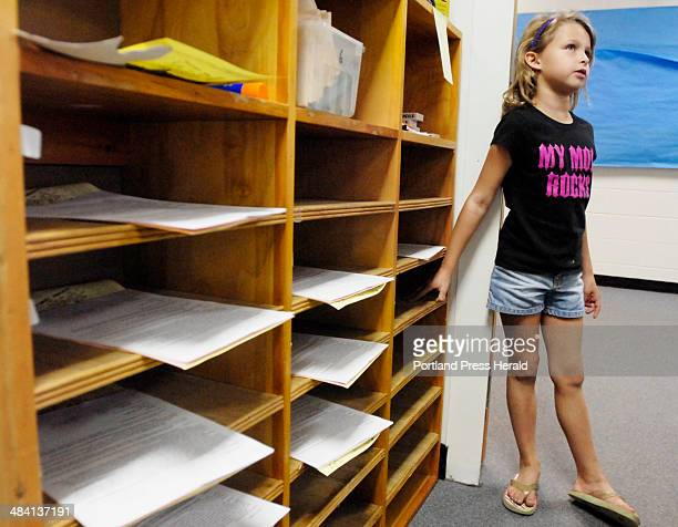 Wednesday August 30 2006 Isabel Peredy an incoming first grader at Freeport's Morse Street School located her cubbyhole in her new classroom during...