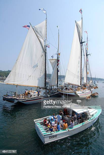 Staff Photo by John Ewing Wednesday June 27 2007 Boatloads of sightseers paraded around the sailing ships anchored in the harbor during Windjammer...