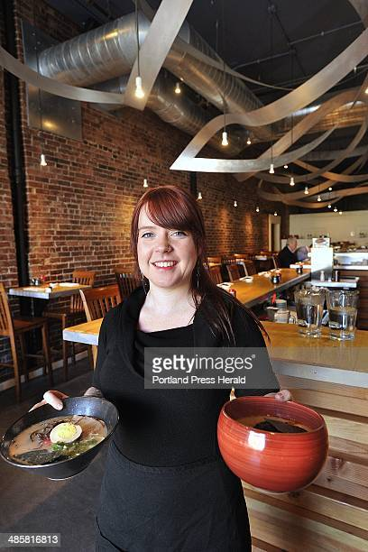 Staff Photo by John Ewing/Staff Photographer Tuesday December 14 2010 Gemma Hancock a server at Pai Men Miyake with a ramen dish and a bowl of spicy...