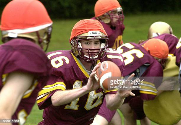 Staff Photo by John Patriquin Monday August 15 2005 Thornton quarterback Brian Morrison pitches the ball during team practice today in Saco