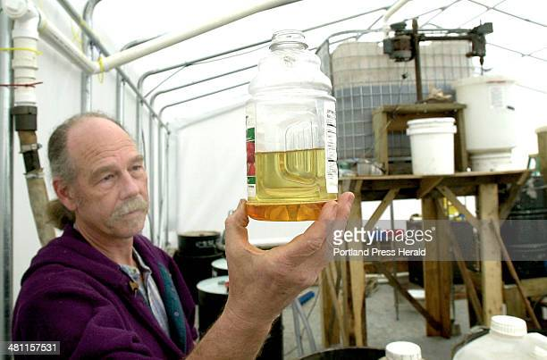 Staff Photo by John Patriquin Thursday March 14 2002 Chewonki Foundation's education coordinator Peter Arnold holds a jug of refined cooking oil he...