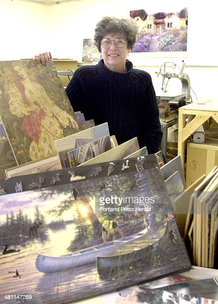 Staff Photo by John Patriquin Tuesday April 9 2002 Betsy Stuart of ELMS Puzzles poses with some of the puzzles her company makes at the Harrison...