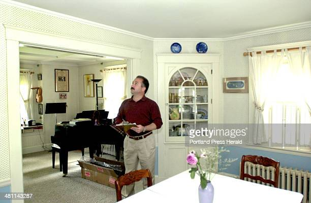 Staff Photo by John Patriquin Tuesday June 18 2002 Insurance appraiser John Paris inspects a home at 40 Woodmont st in Portland
